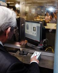 US AMBASSADOR BAKER DEMONSTRATES NEW BIOMETRIC VISA IN TOKYO.