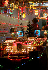 Woman looks at decorative lights in a shop in New Delhi