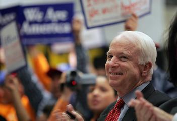 Senator John McCain smiles during a rally in New York