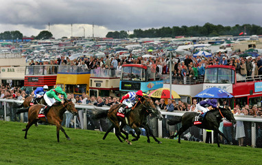 Enforcer ridden by Dwyer runs to the finish line to win the Heritage Handicap at Epsom Derby festival in ...