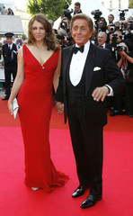 """Italian fashion designer Valentino escorts British actress Liz Hurley as they arrive for screening of Chinese director Wong Kar Wai's in-competition film """"My Blueberry Nights"""" at the 60th Cannes Film Festival"""