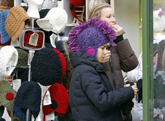 Women shop for hats at Nirvana Designs in New York's Bryant Park