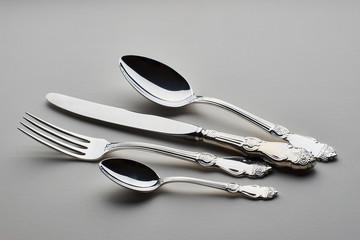Cutlery. Set with fork, knife and spoons on gray background
