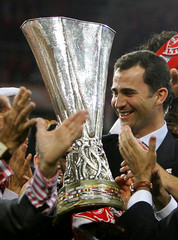 Spain's Crown Prince Felipe holds the trophy won by the players of Sevilla after victory against Middlesbrough in their UEFA Cup final soccer match in Eindhoven