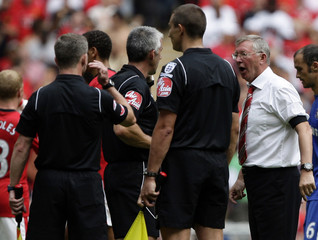 Manchester United's manager Ferguson confronts referee Chris Foy after their English Community Shield soccer match against Chelsea in London