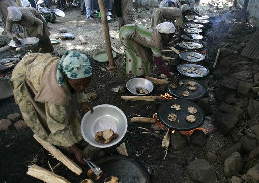 "Ethiopian women prepare ""matzah"" or unleavened bread in Gondor"