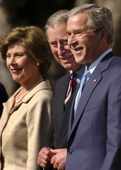 US President Bush and first lady pose for photographs with Britain's Prince Charles at the White House