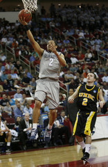 Georgetown University's Wallace goes to basket against University of Maryland-Baltimore County's Greene in Raleigh