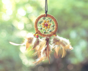 Soft focus on Dream Catcher with natural background in vintage style. Native american dream catcher. boho chic, ethnic amulet.
