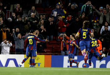 Barcelona's Ronaldinho celebrates with Xavi goal against Celtic during Champions League match in Barcelona