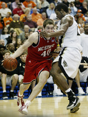 NC State's Brackman gets an arm in his face from Williams of Wake Forest.