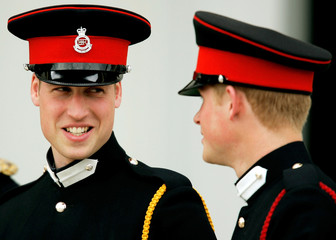 Britains Prince William and Prince Harry chat after Sovereigns Parade at Royal Military Academy in Sandhurst