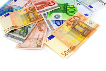 Pile of euro currency banknotes on white background