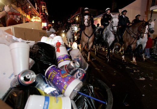 Trash clutters sidewalks as Orleans Parish mounted Police Officers march down French Quarter announcing official end of Mardi Gras in New Orleans