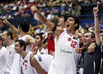 Turkey's Kerem Gonlum and team members react during the final moments of their win over Slovenia at the world basketball championships in Saitama