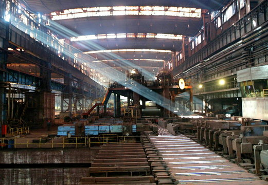 - PHOTO TAKEN 29JUN05 - Light streams into a production hall at a plate mill in Czestochowa, souther..