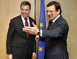 Denmark's PM Fogh Rasmussen is welcomed by European Commission President Barroso at the EC headquarters in Brussels
