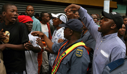 Police confront supporters of former South African deputy president Zuma picketing outside Johannesburg high court