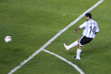 Argentina's Javier Mascherano kicks the ball to score against Paraguay in Match 18 of the Copa America in Barquisimeto