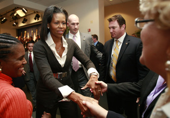 U.S. First Lady Michelle Obama greets staff during her visit to the Department of Education in Washington