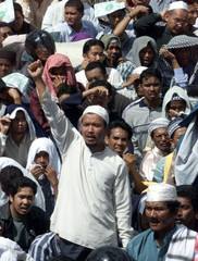 A PROTESTER SHOUTS ANTI-GOVERNMENT SLOGANS IN KUALA LUMPUR.