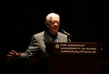 Former U.S. President Jimmy Carter delivers a speech at the American University in Cairo