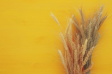 wheat crop on wooden table. Symbols of jewish holiday - Shavuot