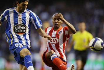 Deportivo Coruna's Lassad battles for the ball with Atletico Madrid's Assunsao during their Spanish First Division soccer match in Coruna