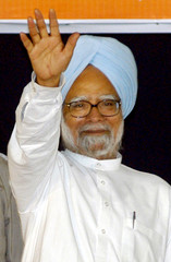 Indian PM Singh waves to people during an election rally in Chennai
