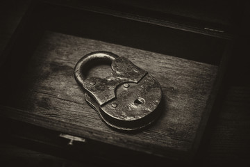 Vintage metal padlock to a wooden surface. Vintage style