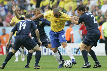 Brazil's Ronaldo battles for ball with Australia's Chipperfield, Grella and Neill during their Group F World Cup 2006 soccer match in Munich