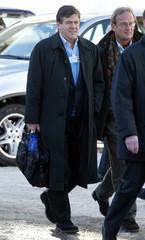 DEUTSCHE BANK CHIEF EXECUTIVE ACKERMANN WALKS THE STREETS OF DAVOS.