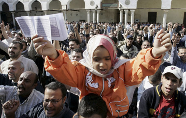 Muslim Brotherhood members demonstrate after their Friday prayers outside Al-Azher mosque in Cairo