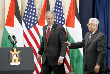 U.S. President Bush and his Palestinian counterpart Abbas arrive for a joint news conference in Ramallah