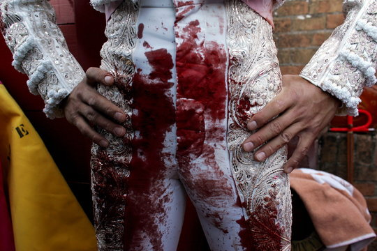 Spanish matador Cesar Jimenez stands in the space between the inner and outer barriers after killing..