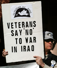 VETERAN FOR PEACE HOLDS SIGN OPPOSING POSSIBLE WAR.