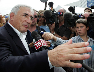 Former French Finance Minister Strauss-Kahn speaks with journalists in France.