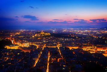 panoramic cityscape of Athens with Acorpolis hill and sea at night, Greecer, retro toned