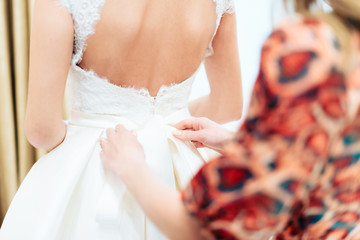 bride in white dress backs to the camera