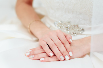 the bride's hand with a manicure