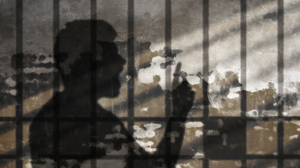 Man Shadow Talking Under Jail Bars. Freedom of Speech Metaphor. Comic Cloud on Concrete Wall.