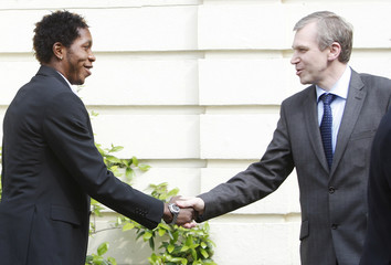 Belgian PM Leterme greets Standard's player Mbokani during a ceremony in Brussels
