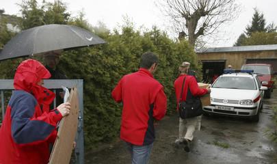 Crime scene investigators enter a backyard of a house in Amstetten in eastern Austria