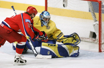 Sweden's goaltender Henrik Lundqvist makes a save on a penalty shot by Russia's Alexei Kovalev ...
