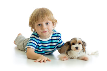 Child boy and puppy dog looking at camera isolated on white background