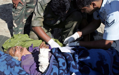 Indian army and air force doctors attend to Kashmiri earthquake victim in Tanghdar