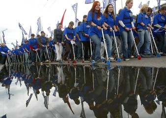 Activists of the New Civil Generation youth movement use scooters during their march in central Moscow