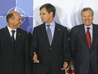 Romanian President Basescu Netherland's Prime Minister Balkenende and NATO secretary General de Hoop Scheffer arrive for a working dinner at the NATO summit in Bucharest