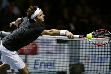Federer of Switzerland misses shot from Davydenko of Russia during ATP World Tour Finals semi-final tennis match in London