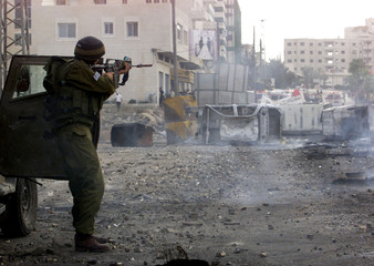 ISRAELI SOLDIER TAKES AIM AT PALESTINAIN PROTESTERS DURING CLASHES IN THE WEST BANK CITY OF RAMALLAH.